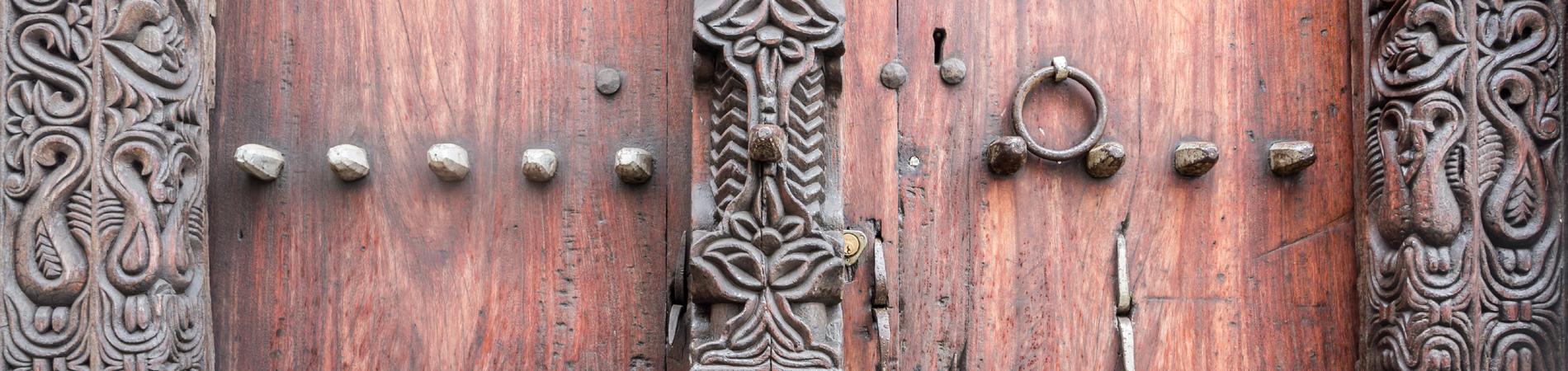 shutterstock znz header stone town door