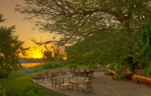 Sunset over the dining deck at Kanyemba