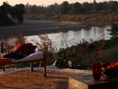 Day beds overlooking the Banjar River at Flame of the Forest