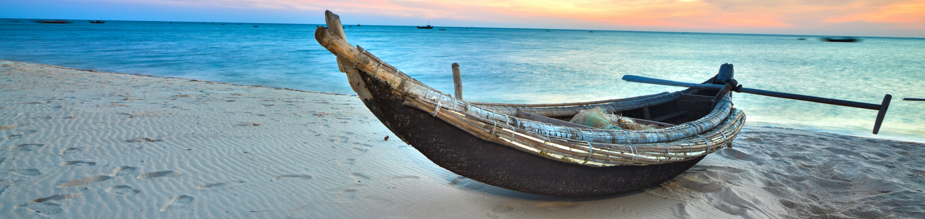 shutterstock_vietnam boat beach header